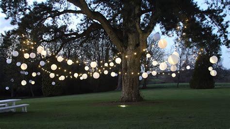 festoon lighting and ivory outdoor lanterns hanging