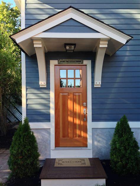 custom structural brackets  small roof overhang   garage door design house