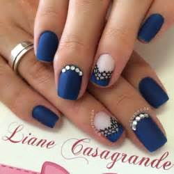 Blue floral nail art design the nails are painted in baby