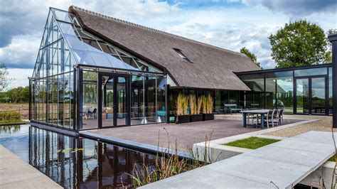 cottage meets greenhouse  modern thatched home