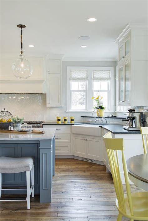 gray kitchen  yellow chairs cottage kitchen