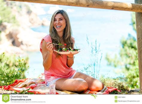 Attractive Woman Having Healthy Picnic Outdoors. Stock