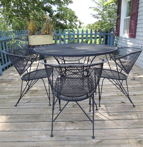 wrought iron mesh patio table and four chairs ebth