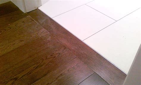 hardwood flooring connection to tile metal stripe   Carpet