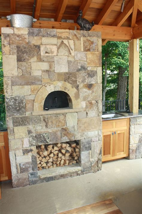 outdoor stone pizza oven  wood box  attached