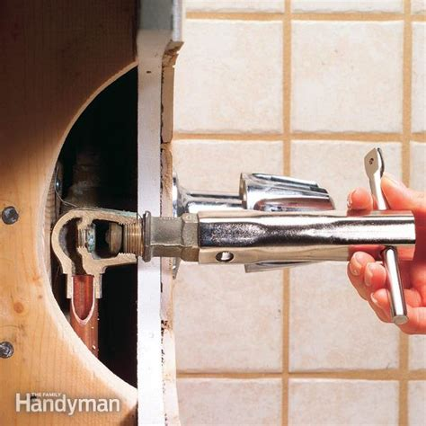 fixing a leaking faucet bathtub how to repair a leaking tub faucet the family handyman