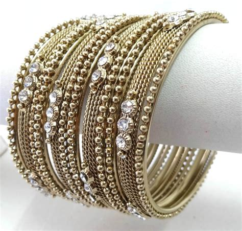 Indian Bollywood Costume Kundan Style Bangles Bracelet. Sleeve Bands. Shop Gold Jewellery. Diamond Cut Gold Bracelet. Stainless Steel Chains. 3 Diamond Necklace. Gold Anklet. Womens Ankle Chains. Country Rings
