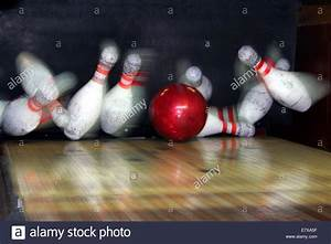 A perfect ten pin bowling strike, with all pins frozen as ...