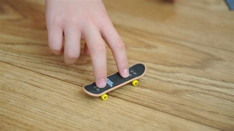 tech deck board tricks how to ollie on a tech deck using three fingers 6 steps