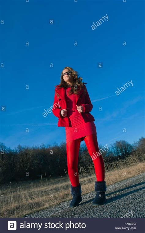 teen girl dressed  red outdoors angled view tights