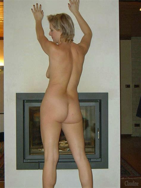 Blonde Mature Is Naked By The Fireplace