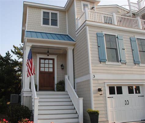 beach house exterior blue metal room tan siding carriage door garage doors texas beach