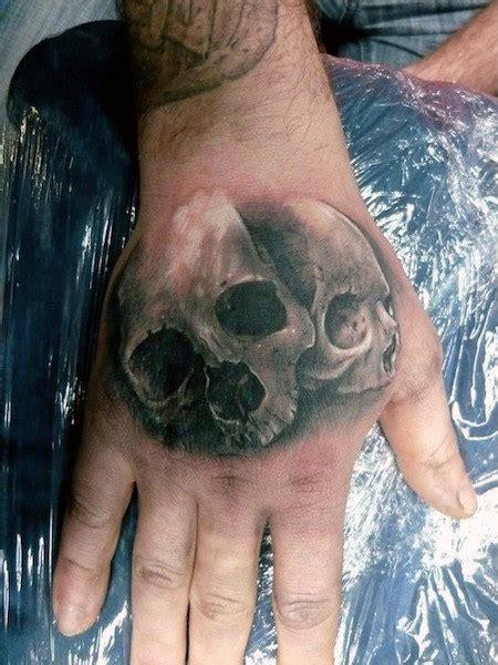 skull hand tattoo designs  men manly ink ideas