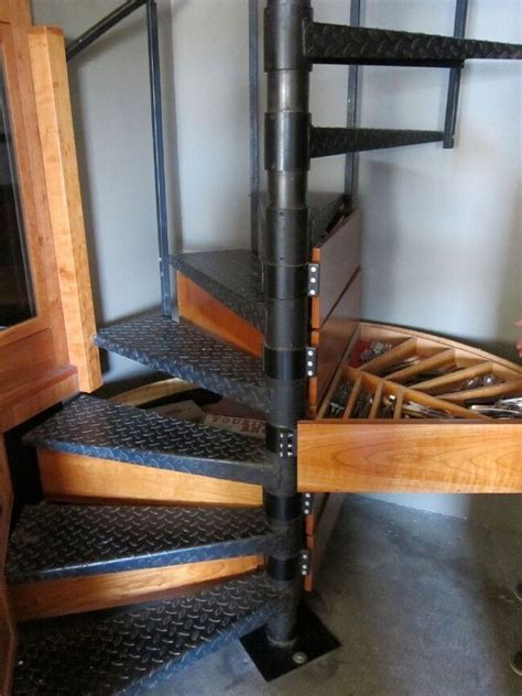spiral staircase storage conceal storage in your spiral staircase that s clever and design and tiny home ideas