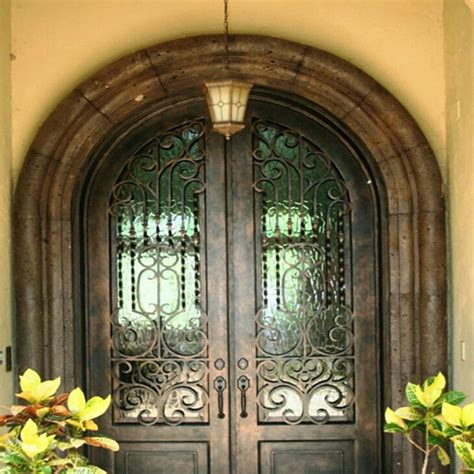 strong arch top double wrought iron door  grills