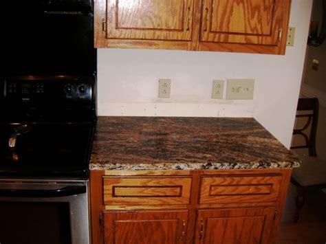 granite for oak cabinets traditional