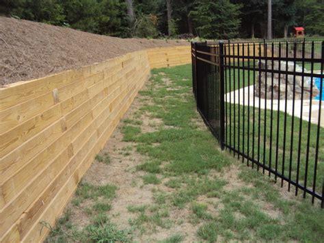 backyard pool pressure treated timber retaining wall traditional landscape atlanta