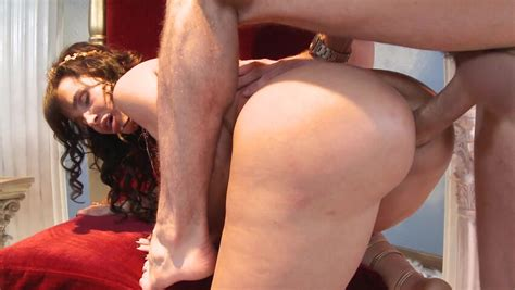 A Milf That Enjoys Showing Off Her Huge Tits Is Riding A
