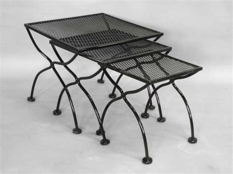 wrought iron and mesh nest of outdoor tables by
