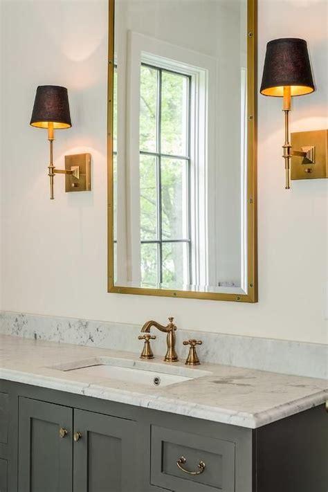 Brass Bathroom Mirror by Mediterranean Bathroom Features A Gray Vanity Adorned With