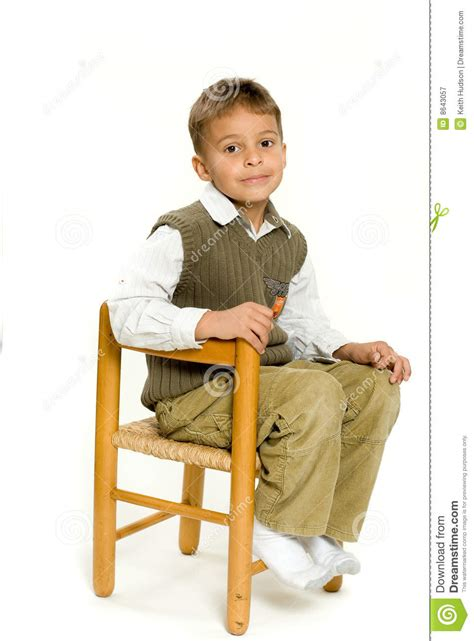 Young Boy Sitting In Chair Stock Image Image Of Sitting