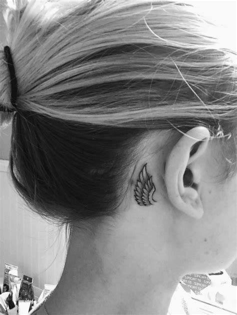 Behind the ear wing tattoo