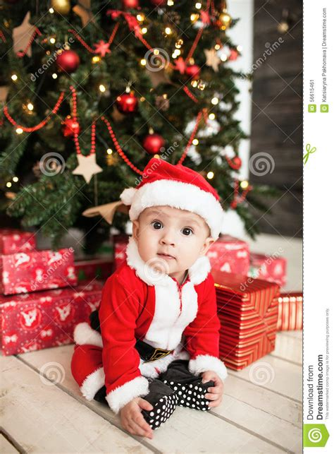 new born baby xmas photo baby in santa suit with gifts near tree stock image image 56615461