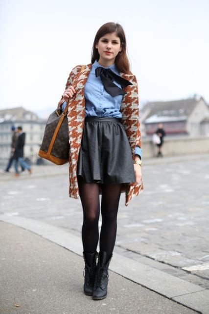 Picture Of With blue shirt leather skirt and printed jacket