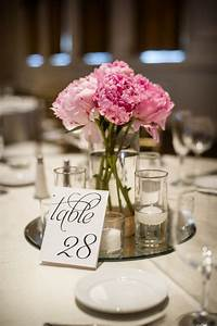 SImple pink peony centerpiece on a mirror base with ...