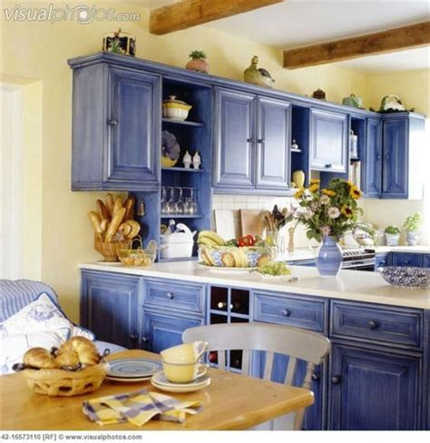 light blue kitchen with white cabinets country blue