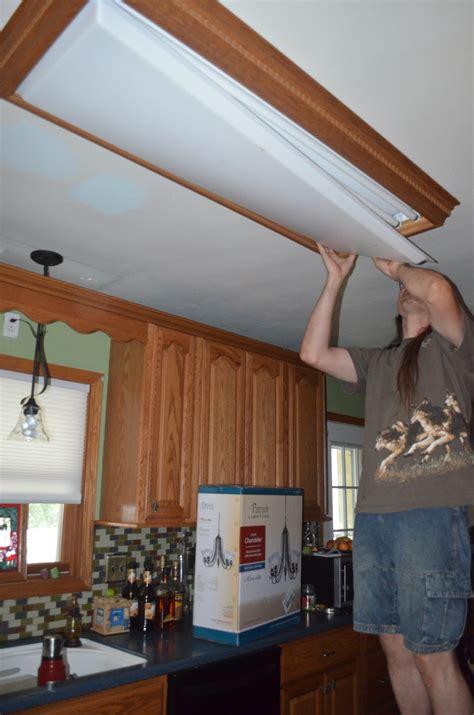 replacing  overhead florescent light   kitchen  wolf den