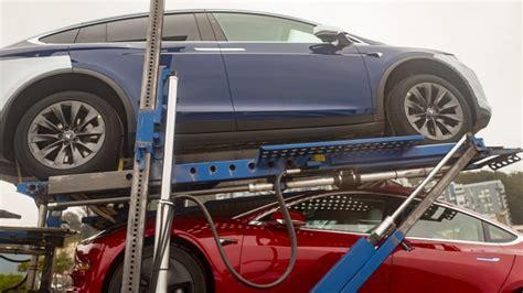 tesla  struggling  insane car delivery logistics