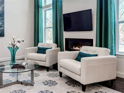 white contemporary living room with turquoise curtains