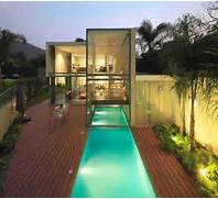 Contemporary House With Indoor Outdoor Pool Design Ideas Home Design The Godden Cres House Is Located In Auckland New Zealand By Kyle Lindsey Custom Homes With Huge Grounds And Large Rectangle Pool Area Pool Has Large