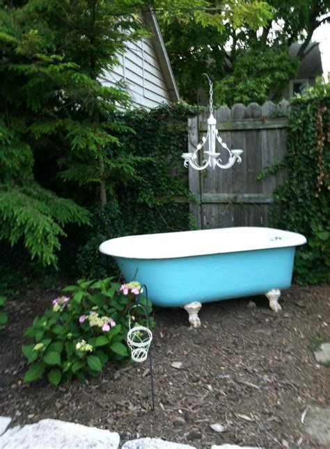antique clan foot cast iron tub adorned with repurposed