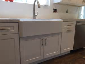 white shaker full overlay kitchen cabinets with quartz