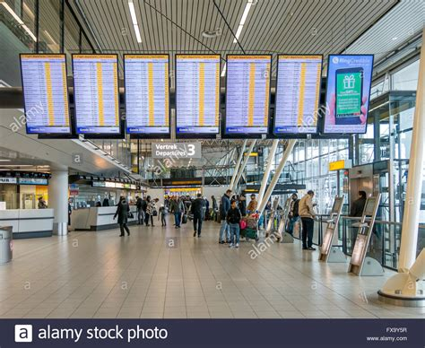 Schiphol Departure by Flight Departures Boards And Passengers In Departure