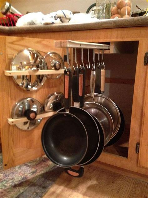 kitchen storage cabinets for pots and pans diy pot rack with pipes from home depot home pot racks