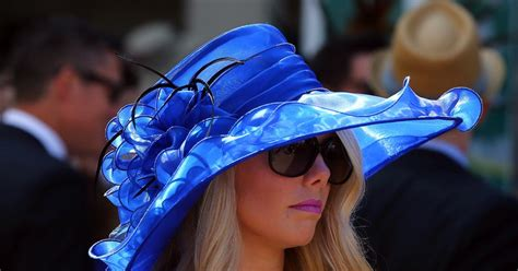 A woman wears a blue hat to Kentucky Derby - Photos - Outfits of the 2015 Kentucky Derby - NY ...