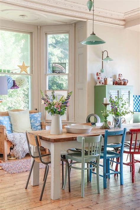 Mixed color chairs and a farmhouse table   Kitchens and
