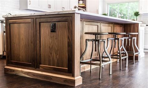 dark walnut island  swivel industrial stools transitional kitchen