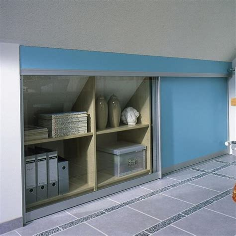 contemporary storage organization  small spaces  sloped ceiling  stairs