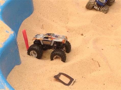 toy monster trucks racing boy playing sand sandpit toy monster truck race