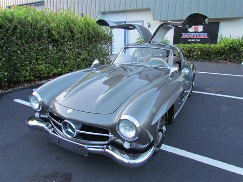The car is finished in its factory color combination of graphite gray (code db190) over a light gray (db955) leather interior. 1955 Mercedes-Benz 300SL for sale #1921843 - Hemmings Motor News