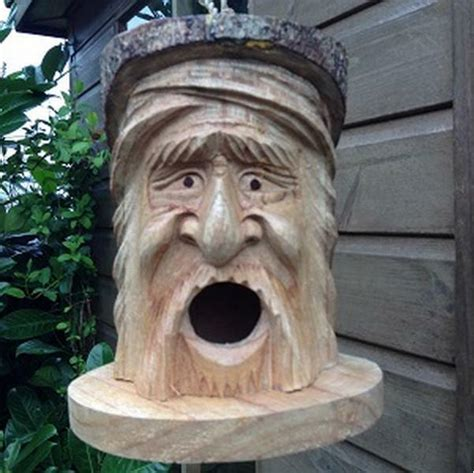 hand carved wooden forest green man bird house nesting box