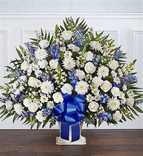 heartfelt tribute blue white floor basket arrangement