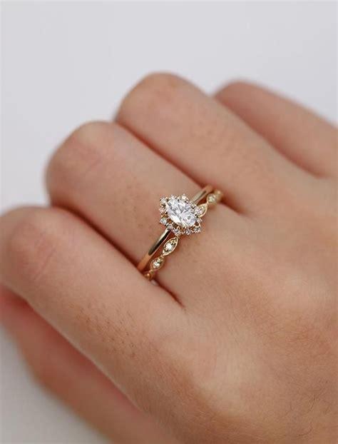 vintage engagement ring oval cut moissanite engagement ring yellow gold diamond halo wedding