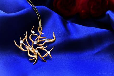 beauty   beast inspired rosetree necklace