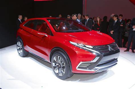mitsubishi plans  family  hybrid suvs   autocar