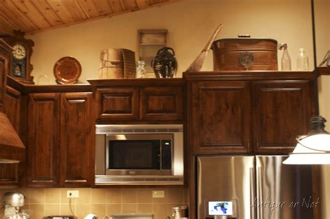kitchen decor above cabinets antique or not decorating above your cabinets 4375